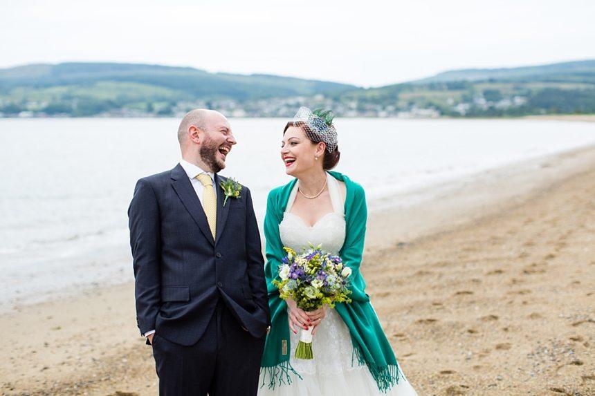 Isle of Arran wedding photography beach portraits of bride & groom relaxed & fun