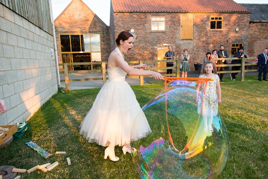 Barmbyfield Barn wedding photography lawn games and hula hoop giant bubbles