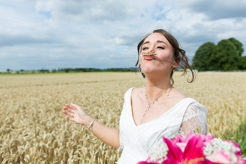Barmbyfield Barn Wedding Photographer Bride and groom portraits in barley field