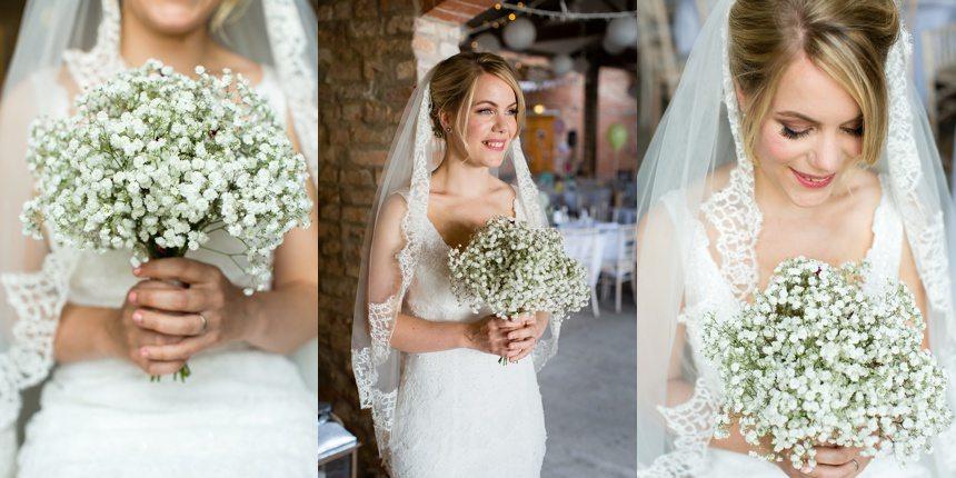 Bride holding gypsophelia bouquet Barmbyfield Barn Wedding