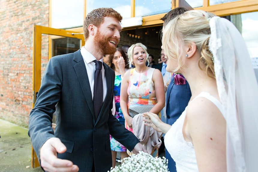 Candid hugs with guests Barmbyfield Barn Wedding