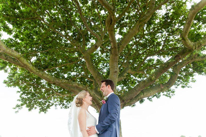 Bride & groom portraits under tree Barmbyfield Barn Wedding