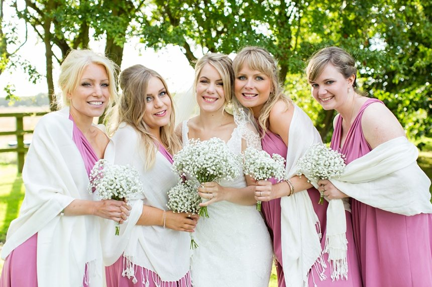 Bride with bridesmaids wearing pink Barmbyfield Barn Wedding Photography