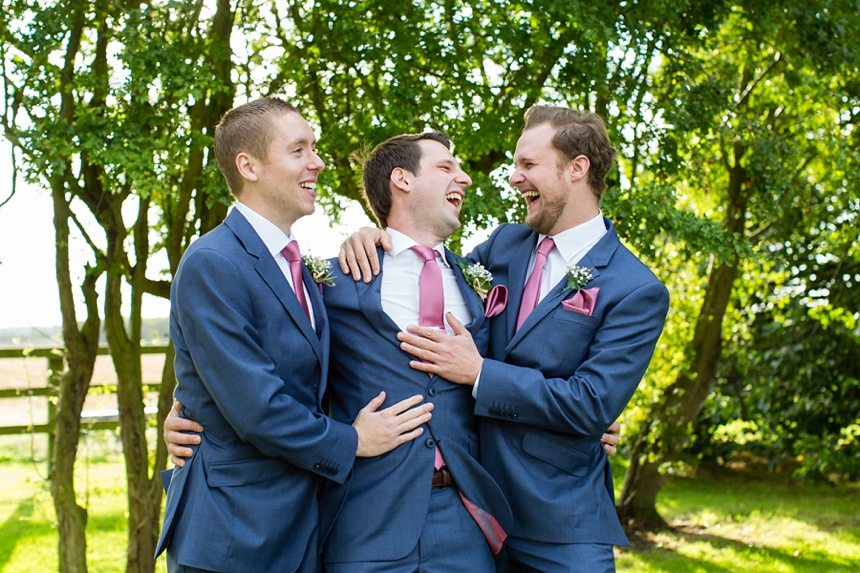 Groom & groomsmen having a big cuddle Barmbyfield Barn Wedding Photography