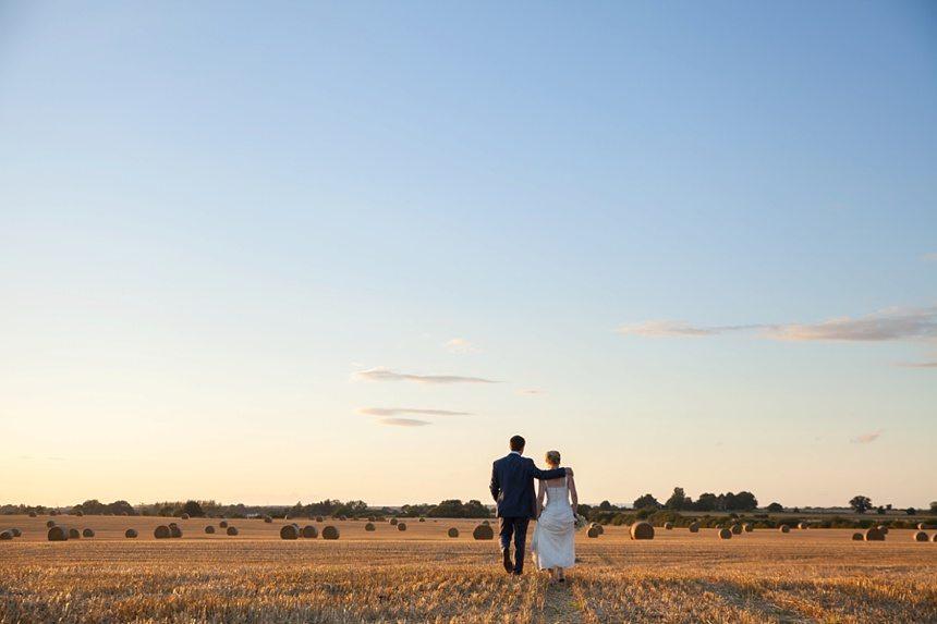 Bride & Groom portraits in barley field Barmbyfield Barn Wedding Photography