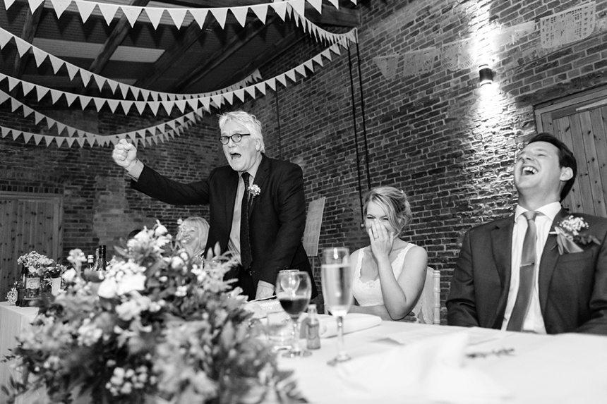 speech bride reacting to father Bride & Groom portraits in barley field Barmbyfield Barn Wedding Photography