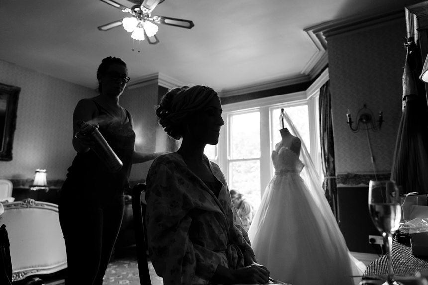 Dark photograph of bride getting ready at Crow Hill Wedding
