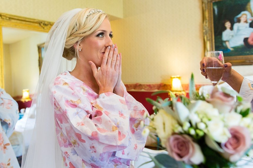 Bride smiles and covers her face at Crow Hill Wedding