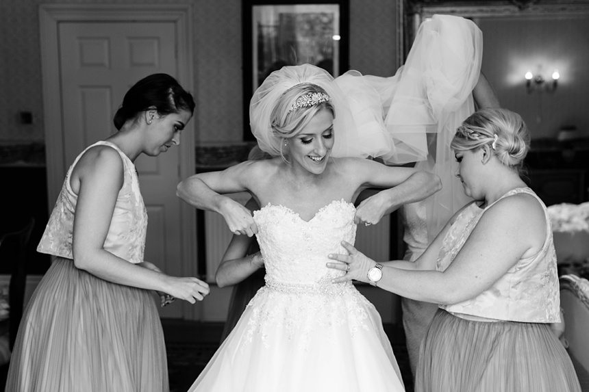 Bride gets into wedding dress at Crow Hill Wedding Tux & Tales Photography