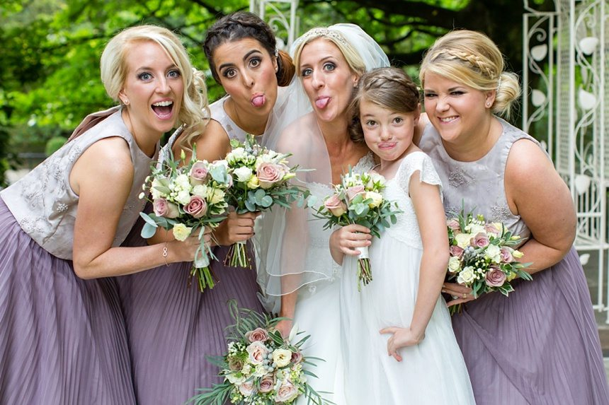 Bride & bridesmaid make silly faces at crow hill wedding