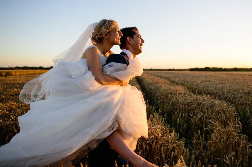 Barmbyfield Barn wedding couple inf ield at sunset