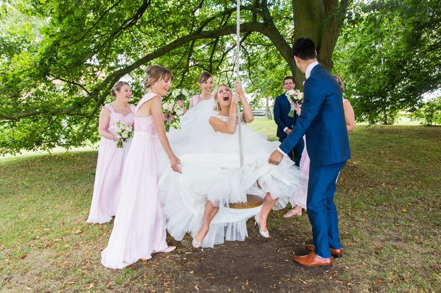 Barmbyfield Barn Wedding tree swing with bride