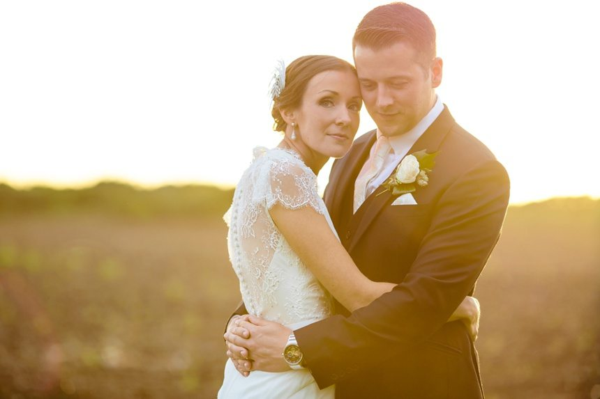 Barmbyfield Barn Wedding bride & groom in sunset