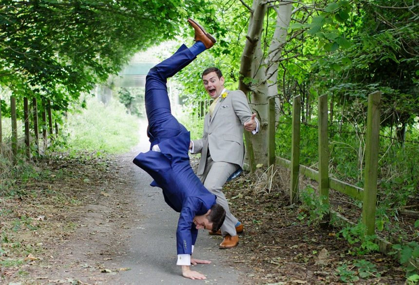 Documentary Wedding Photography Groom doing Cartwheel