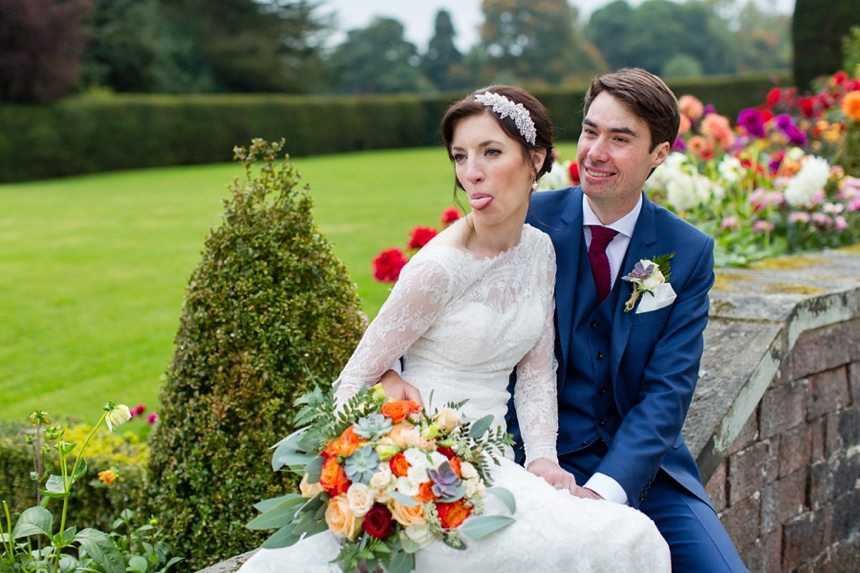 Fun wedding photography bride and groom stick out tongue