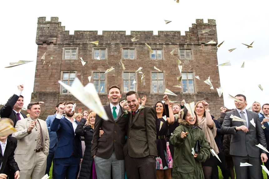 Fun wedding photography paper plane confetti