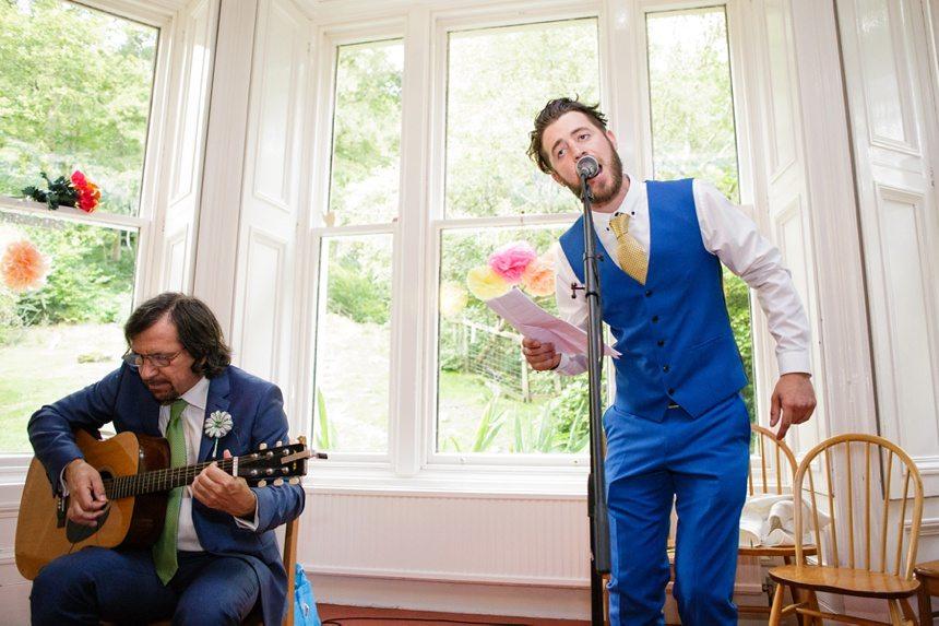 Weddings at Derwentwater Youth Hostel groomsman singing