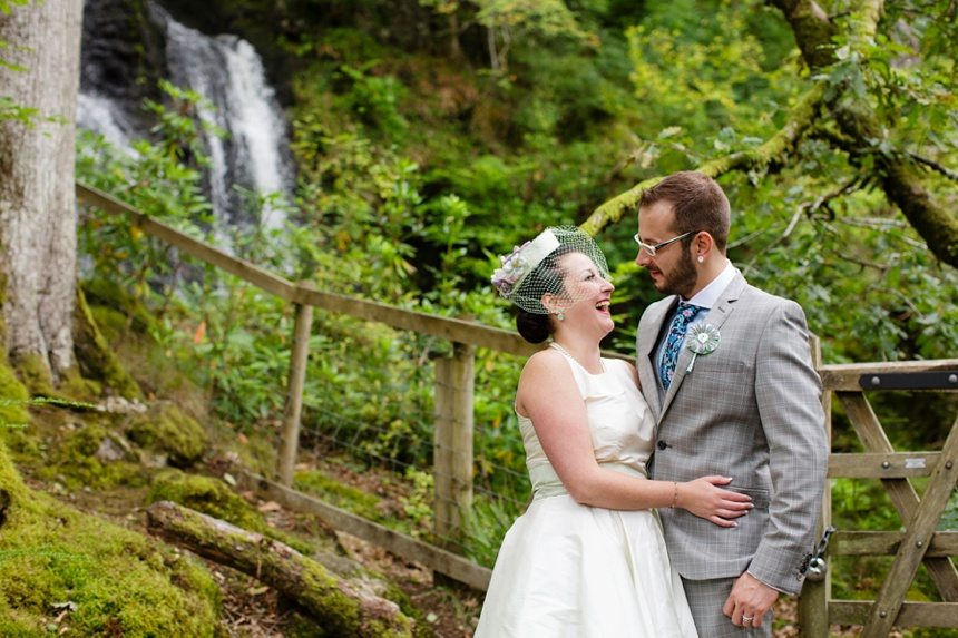 Weddings at Derwentwater Youth Hostel bride & groom in front of waterfall