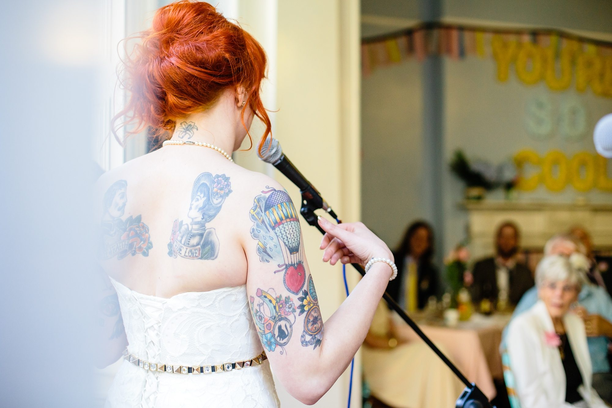 Tattoo Wedding Tips Bride giving Speech with red hair