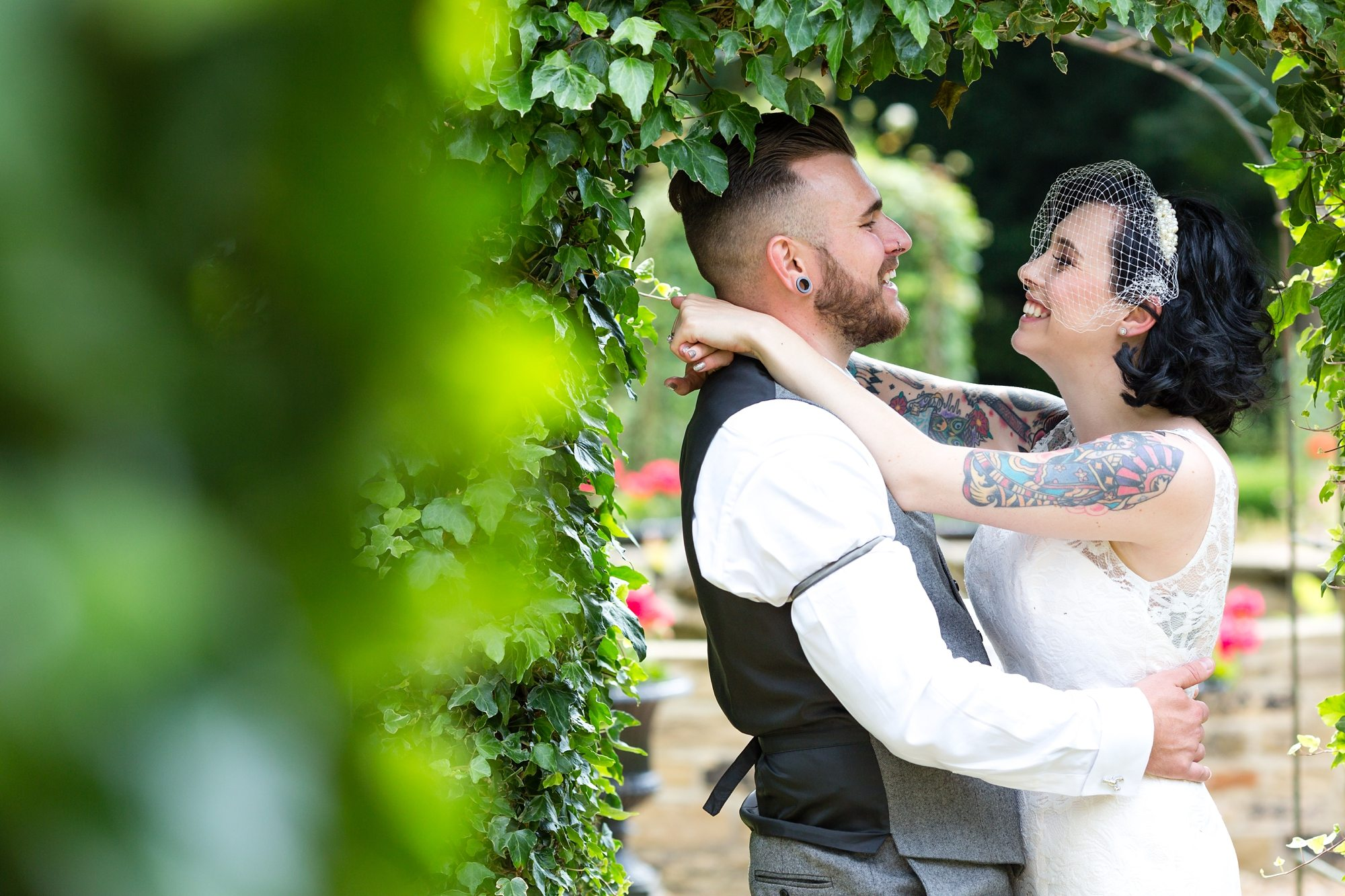 Tattoo Wedding Photography Crab & Lobster Thirsk groom holding tattooed bride in York wedding