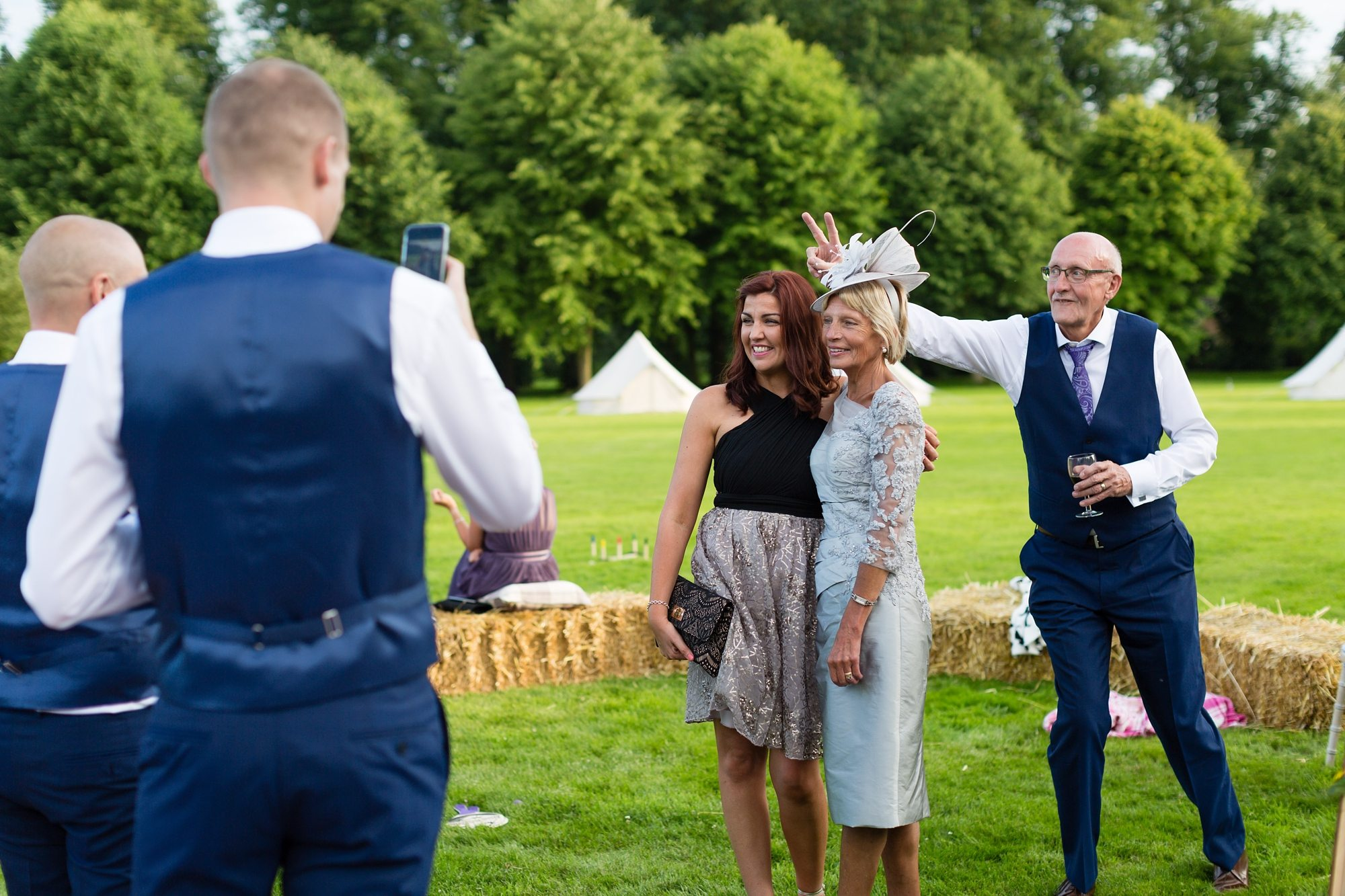 Wedding guests being silly photobomb bunny ears