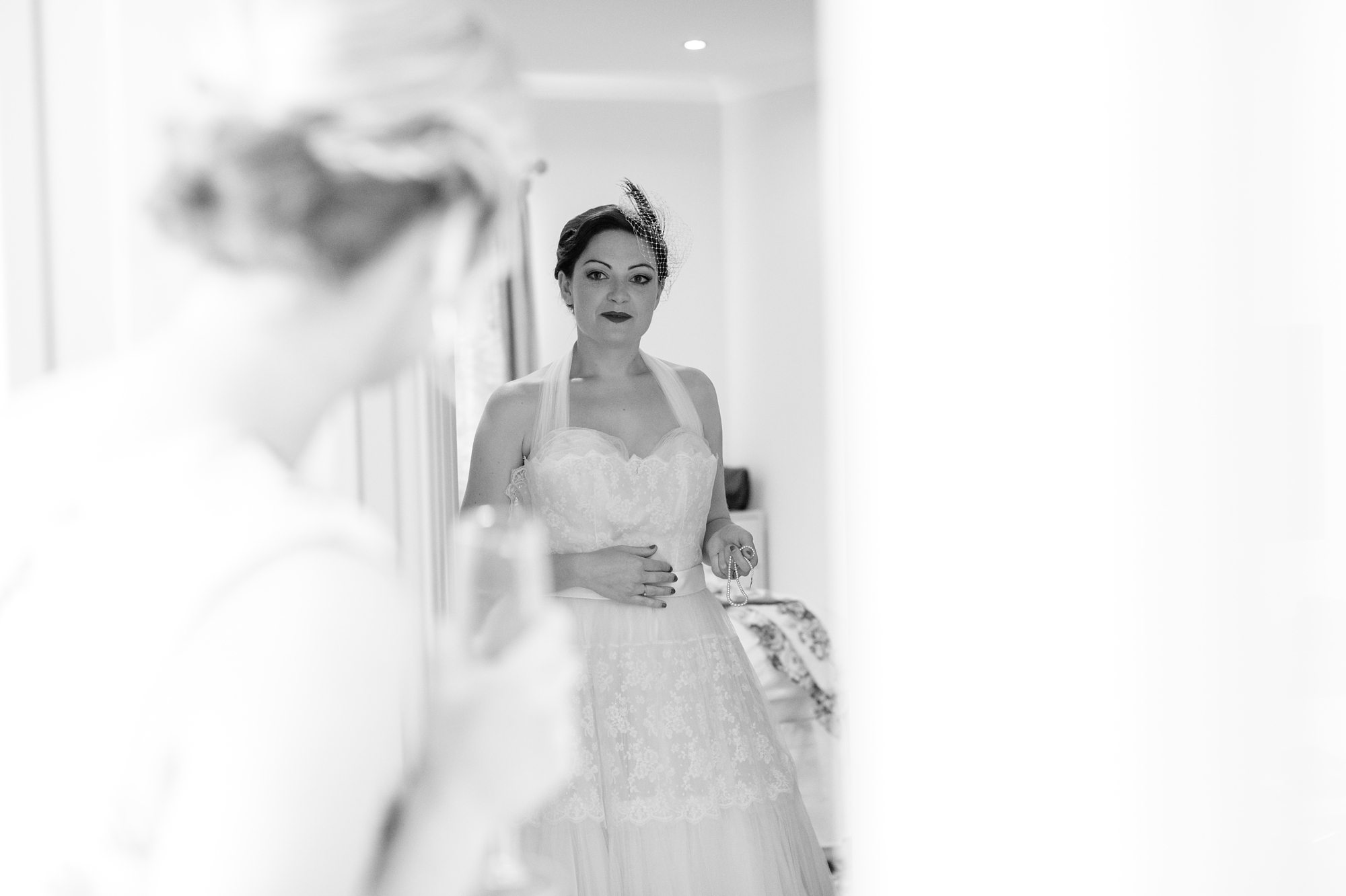 black and white bride in corridor in York barn wedding