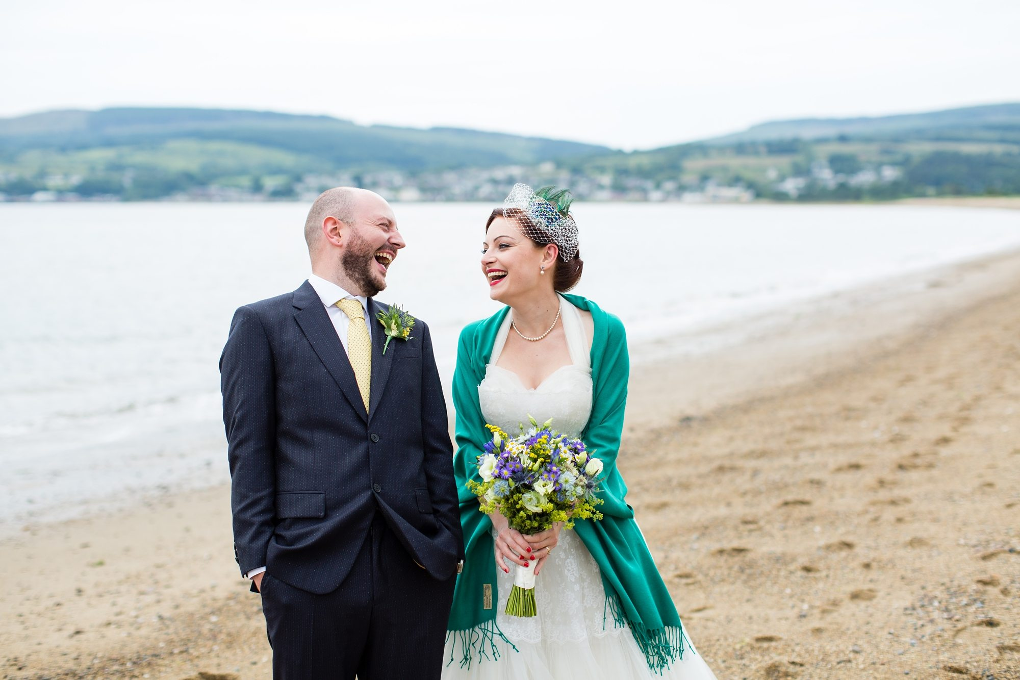 bride and groom laughing on beach in York wedding