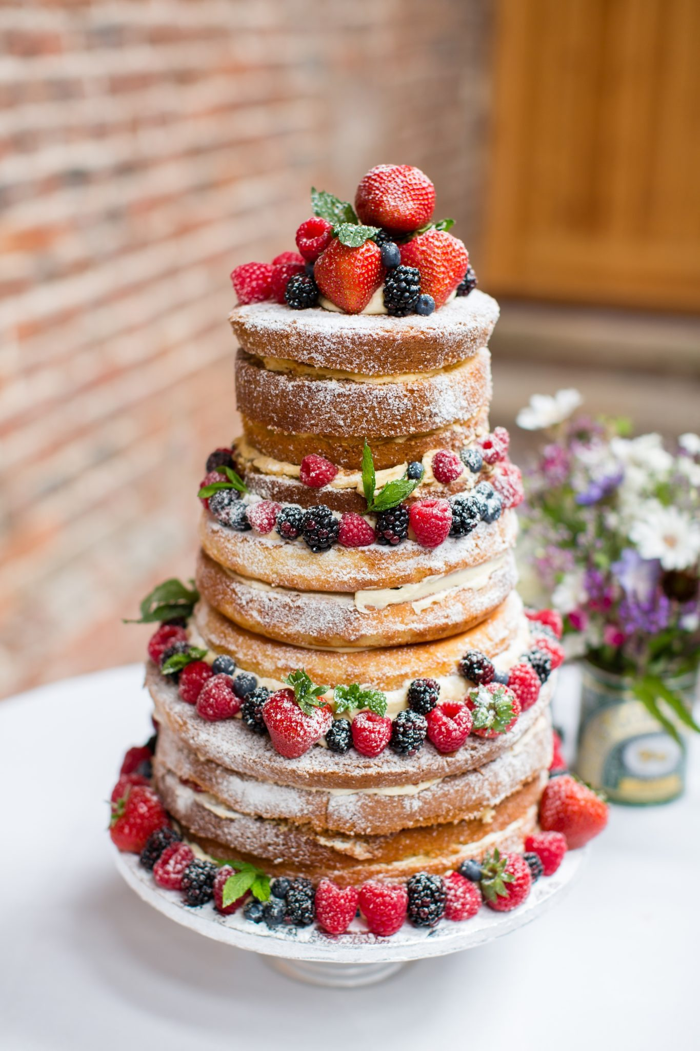 wedding cake with strawberries and blackberries and rasberries