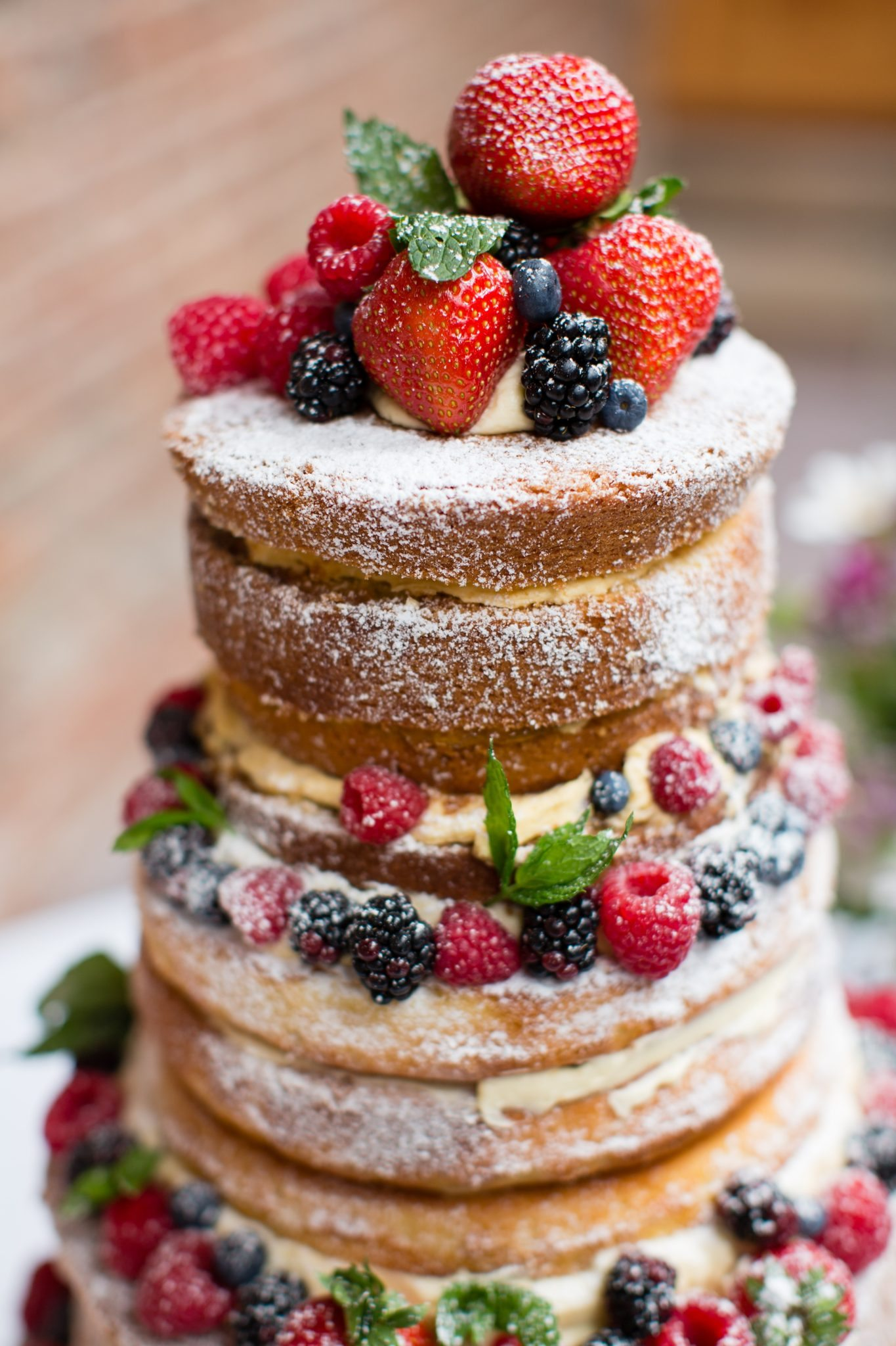 wedding cake with strawberries and rasberries and blackberries
