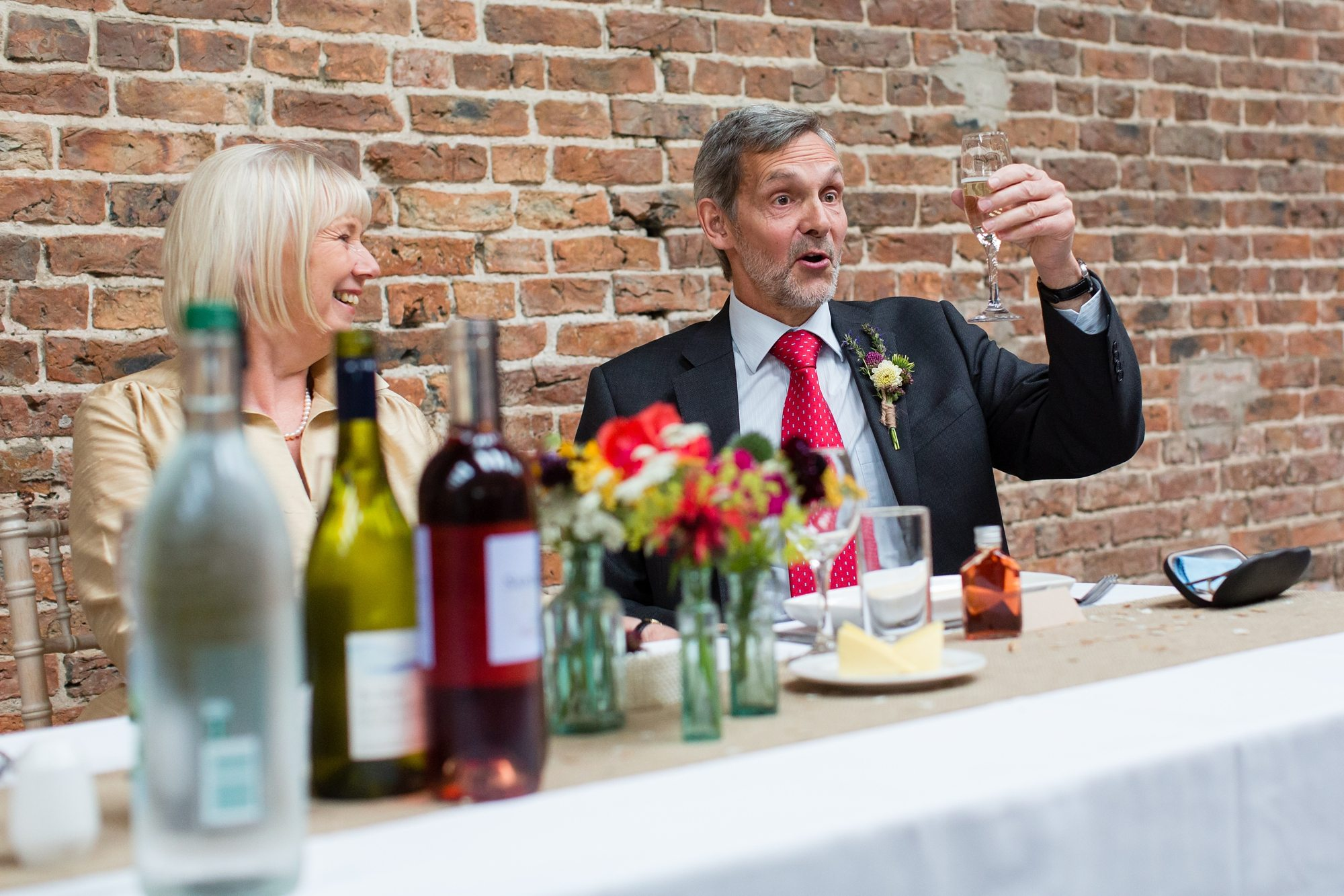 wedding guest looking at wine in York wedding