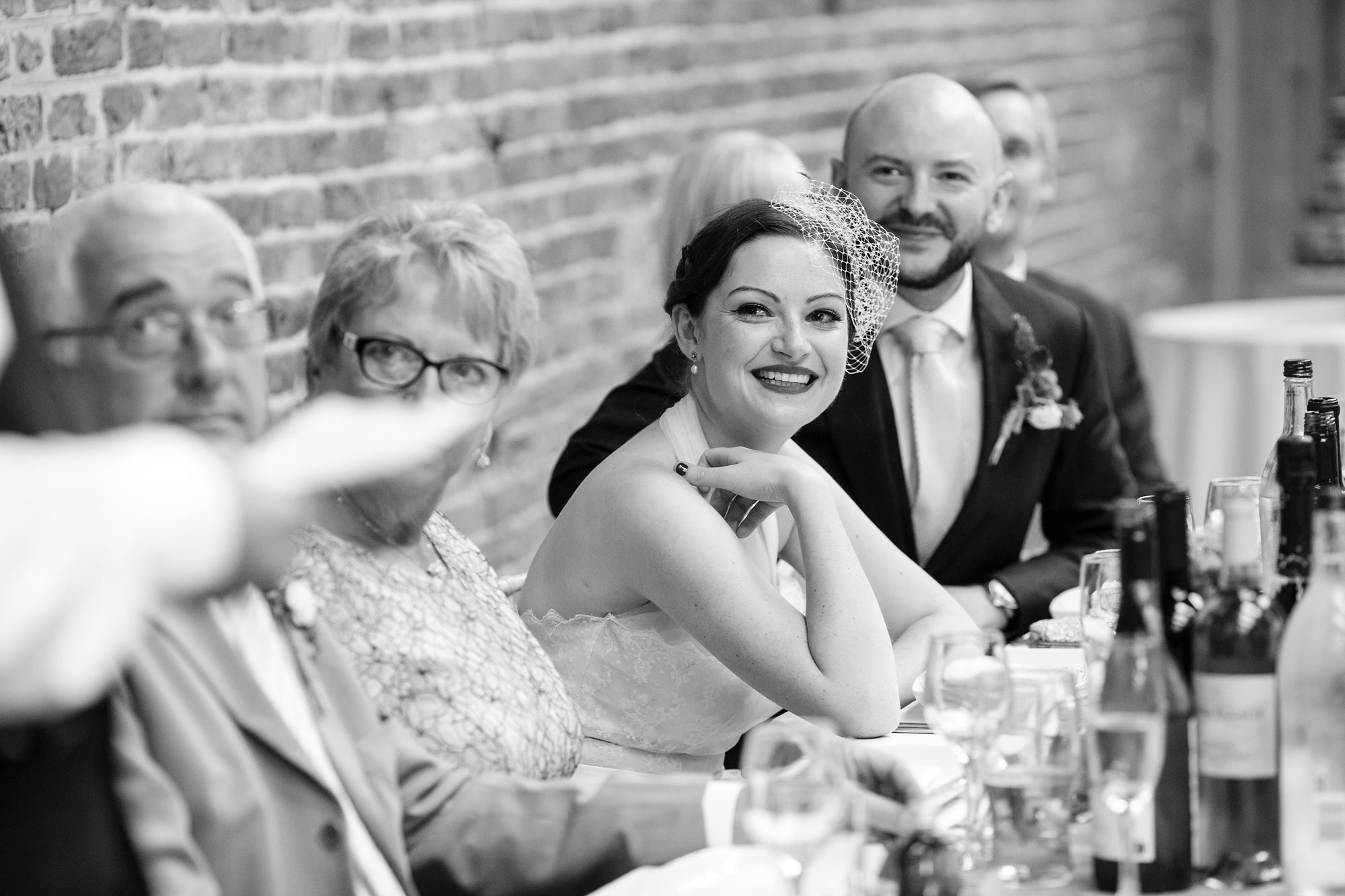 black and white bride smiling with groom