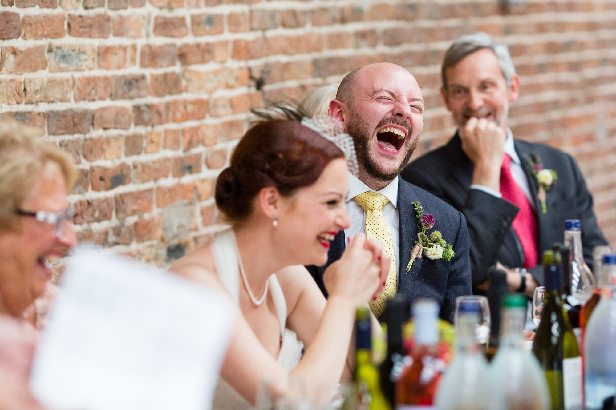 redhead brideand groom laughing at York wedding