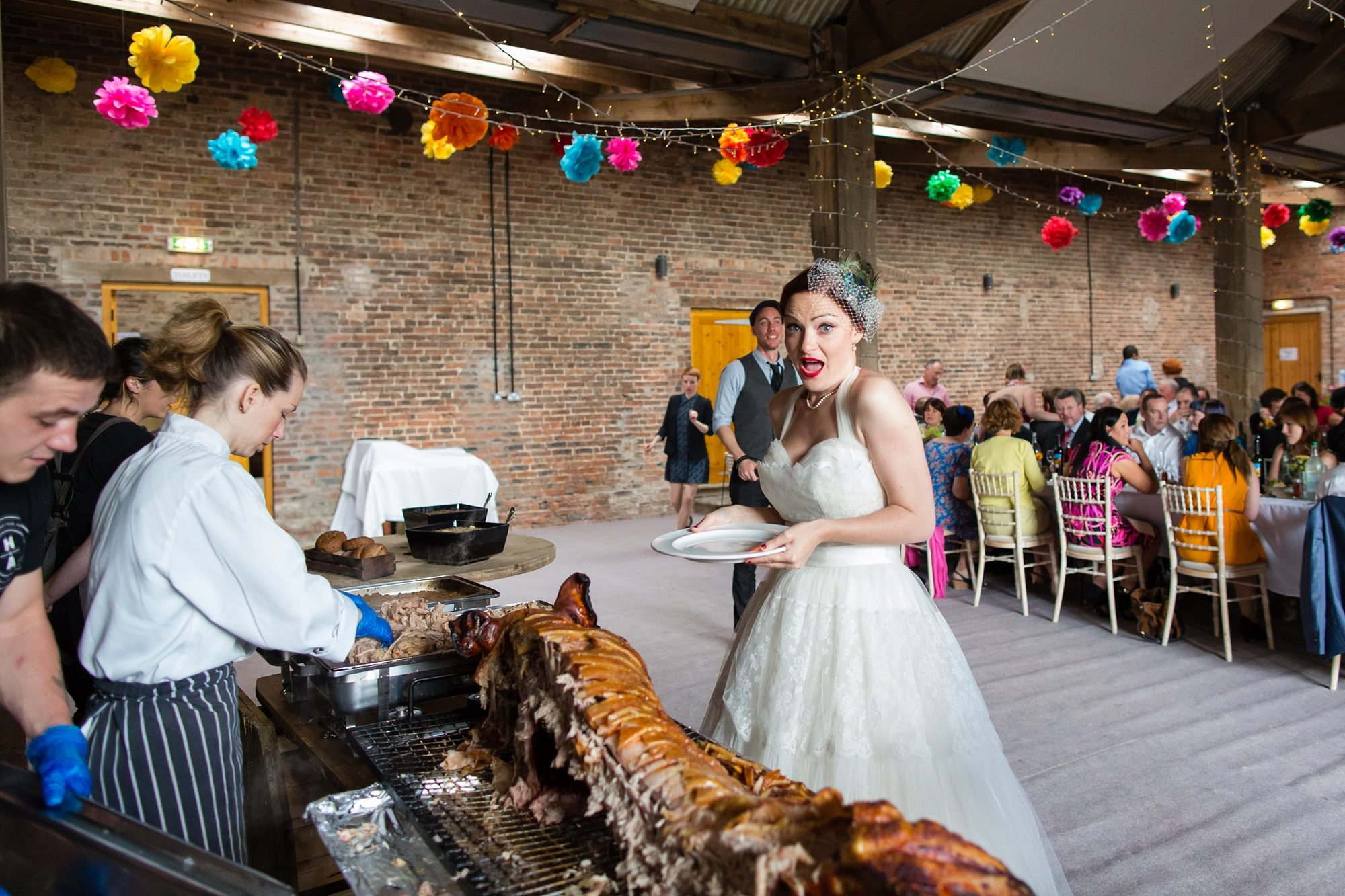 bride having hogroast and pulling face