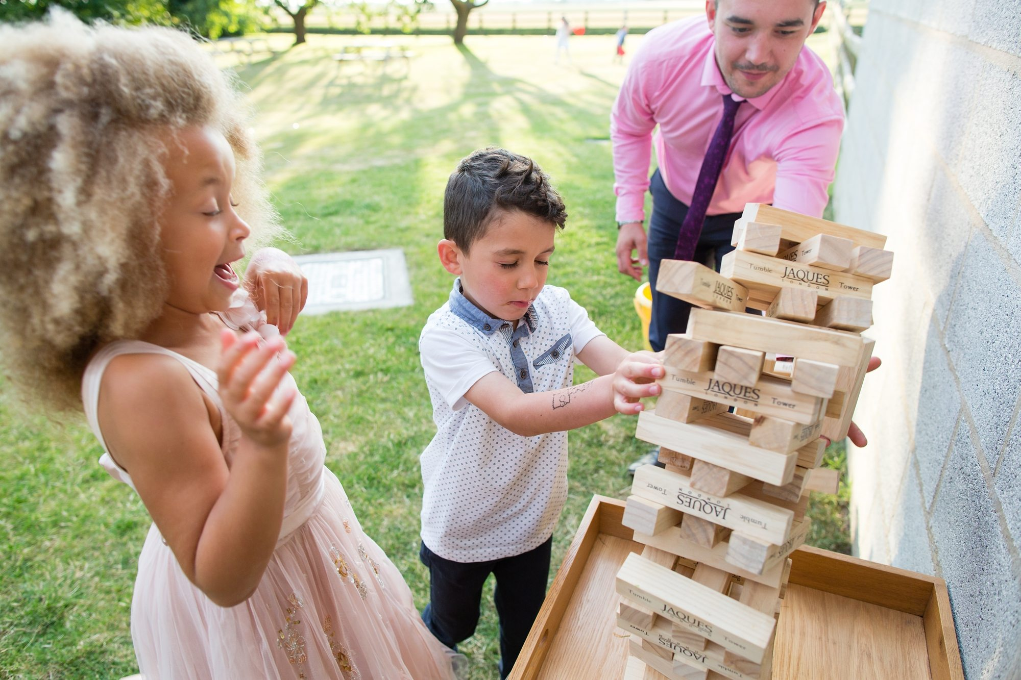 little kids playing jenga in York wedding
