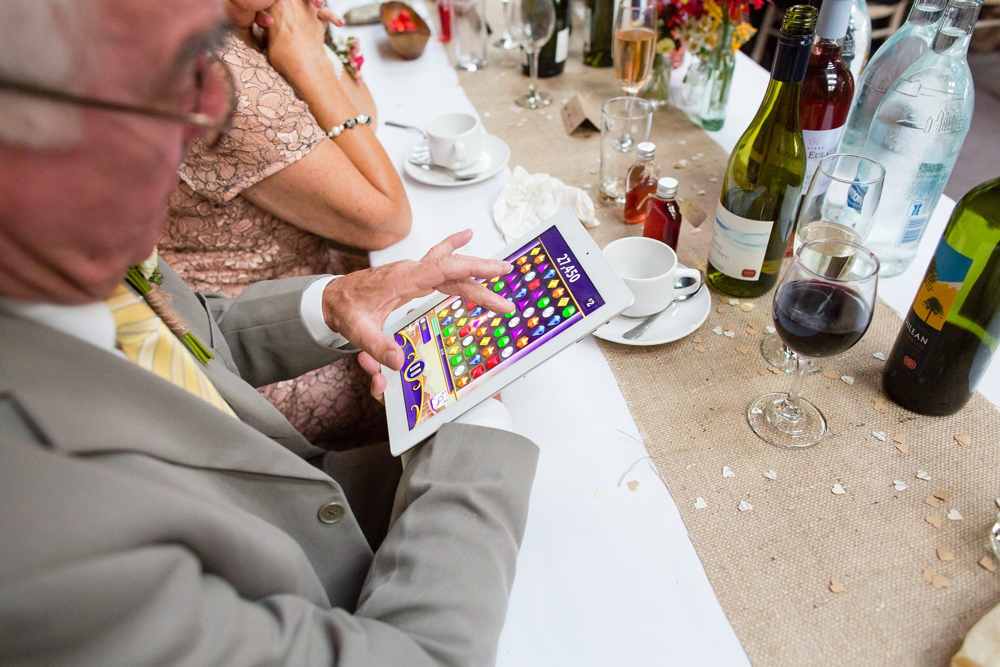 wedding guest using ipad to play bejewled in York wedding