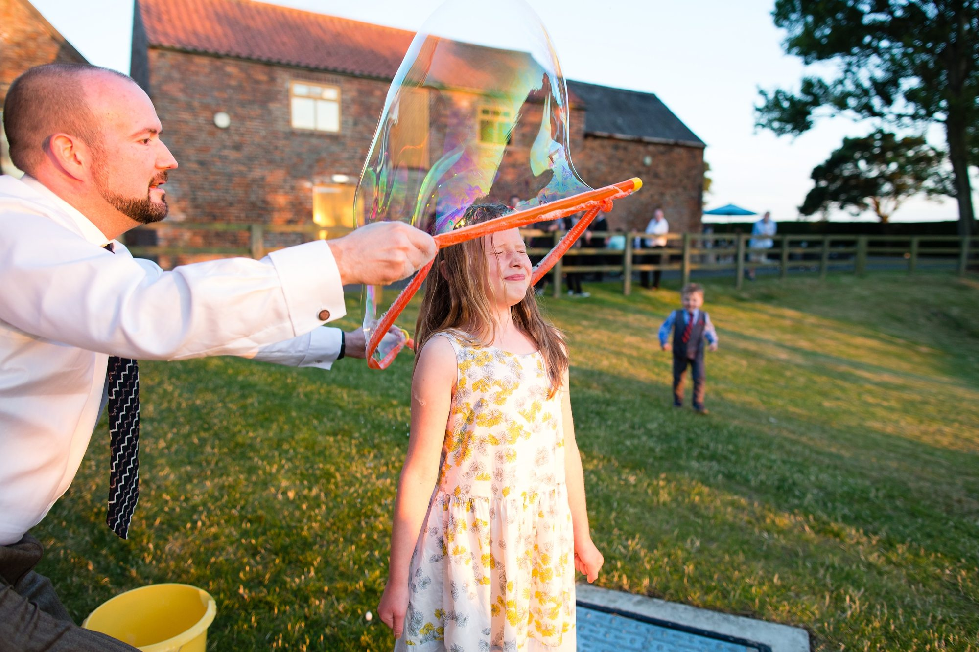 big bubble going over little girl wedding guest in York wedding