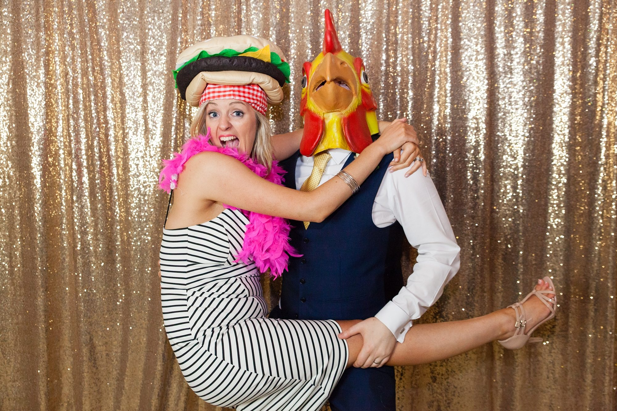 Party photobooth with chickenhead holding guests leg