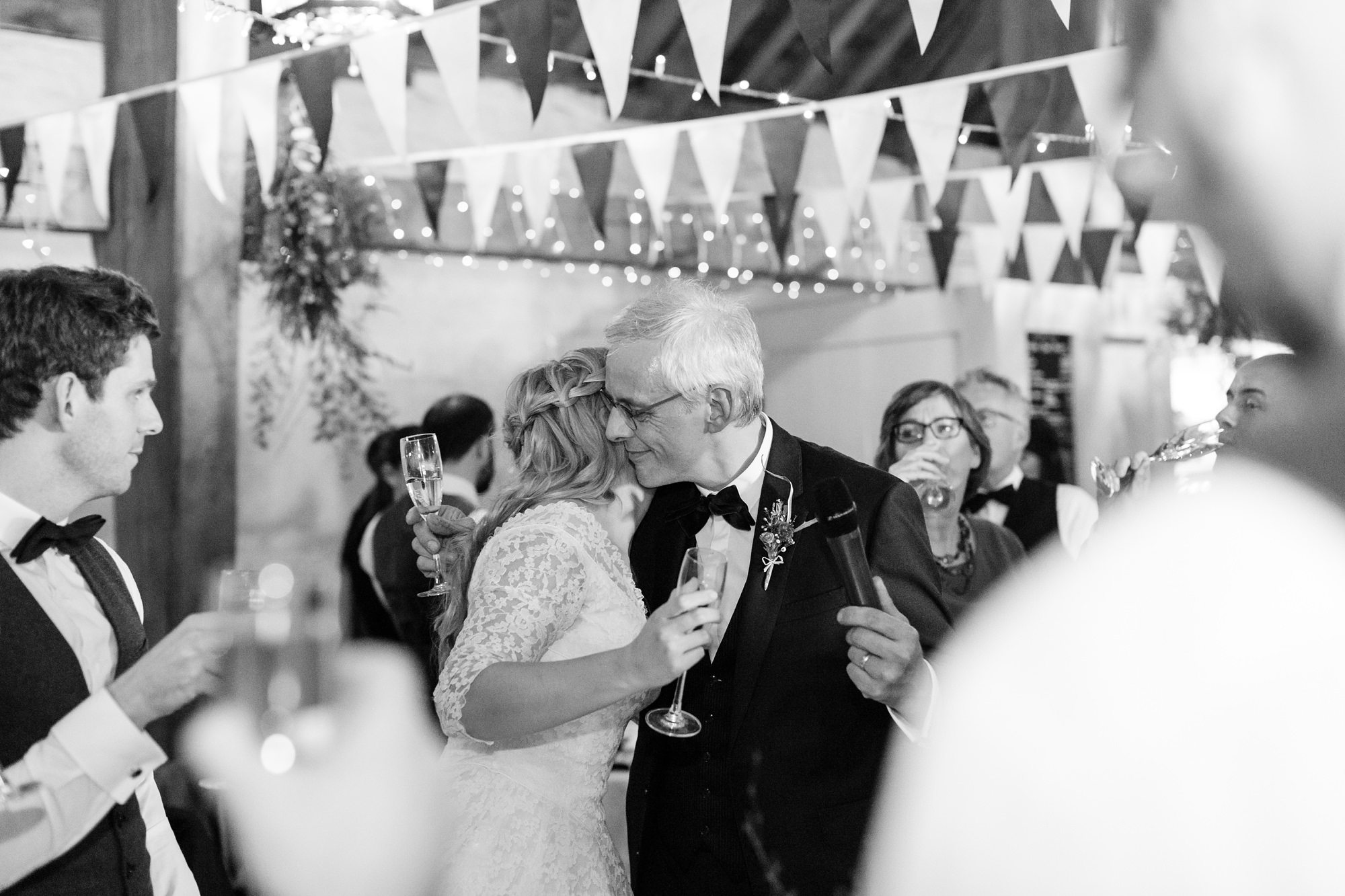 Bride hugs dad after speeches at East Riddlesden Hal Wedding