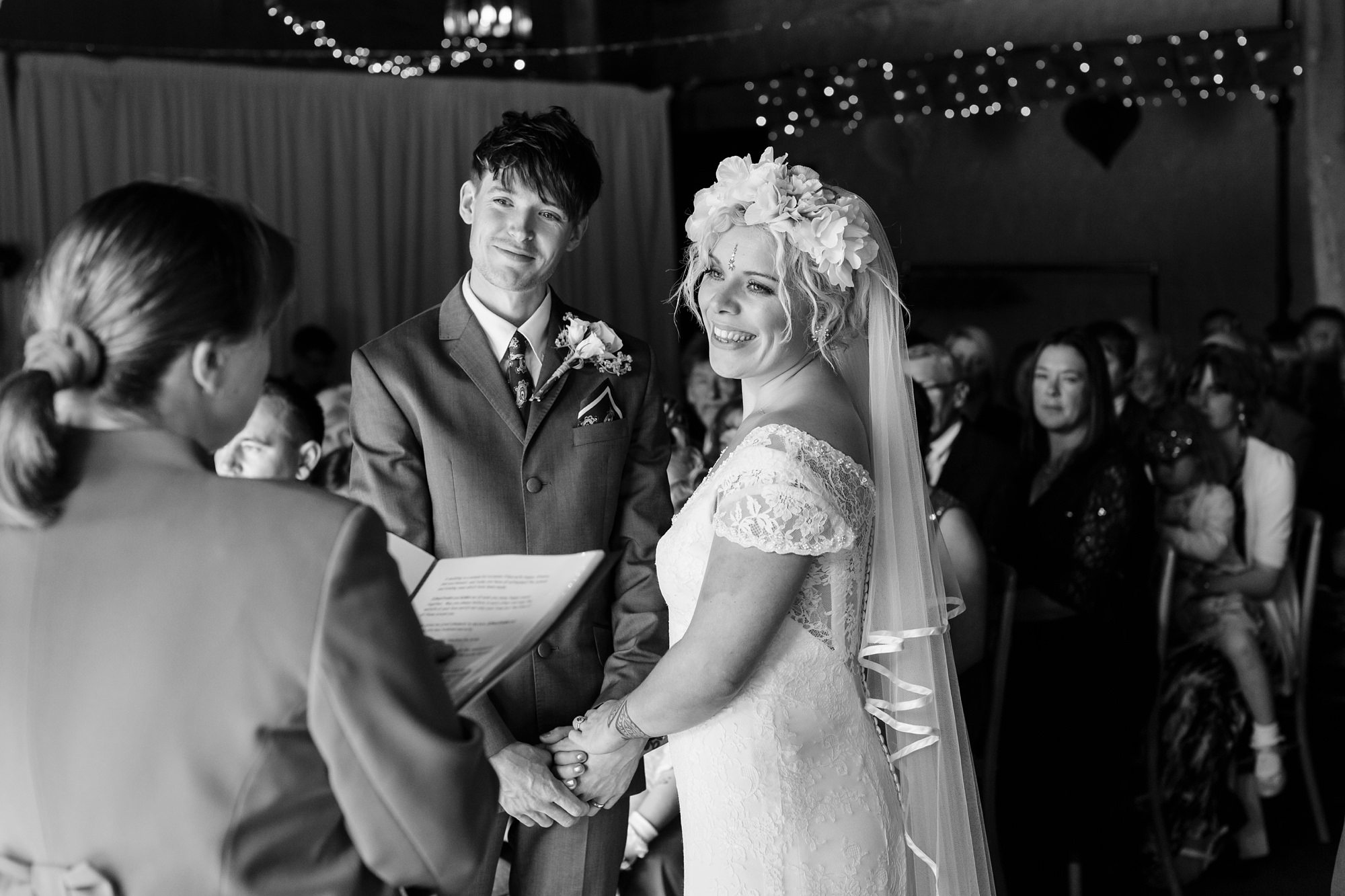 Boho bride with flower corwn during ceremony at East Riddlesden Hall