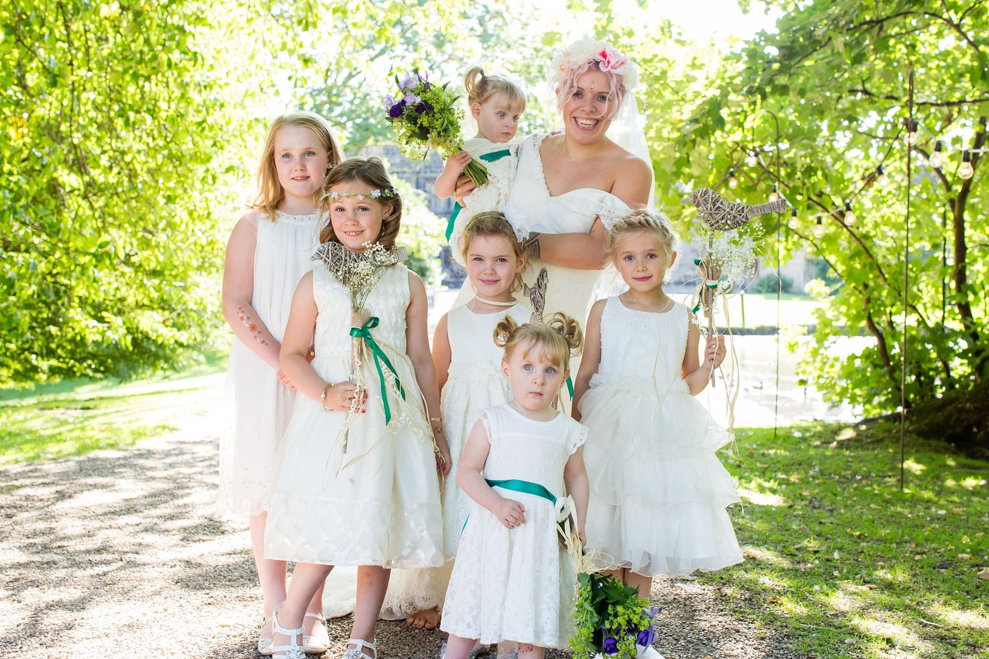 Boho Bohemian Bride and flower girls weating white dresses and flower crowns at East Riddlesden Hall Wedding