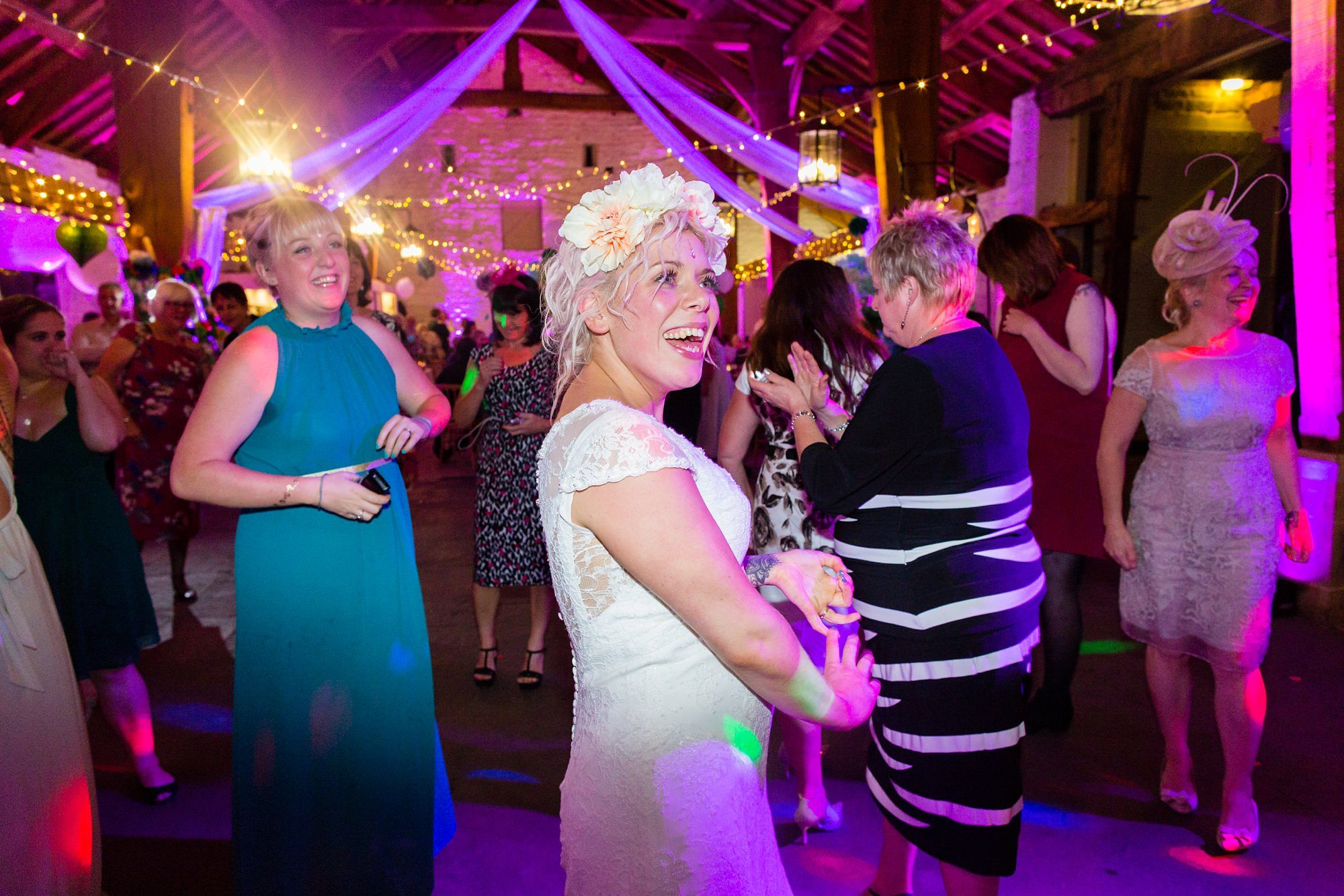 Alterntative bride with flower crown at colourful wedding at East Riddlesden Hall