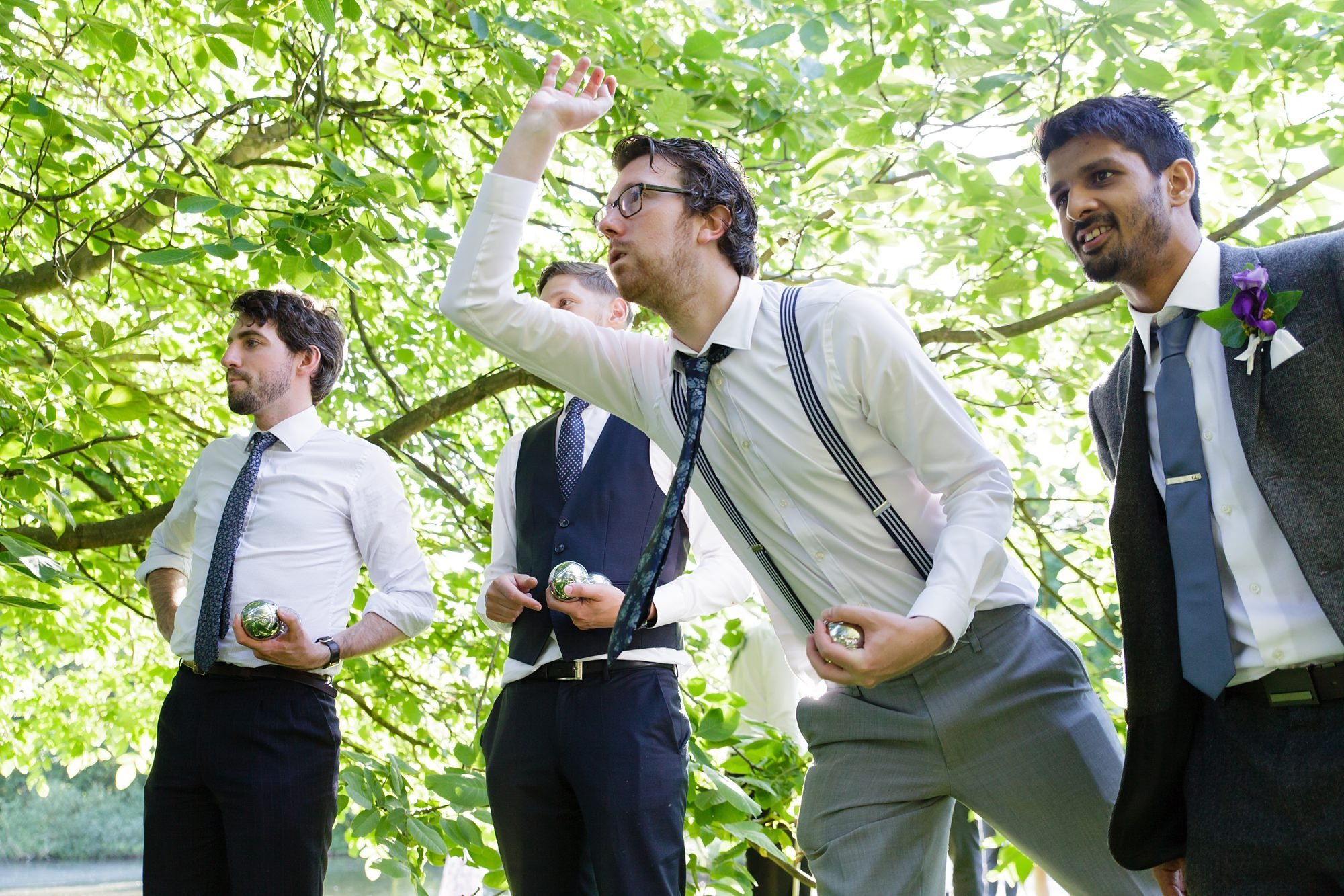 Guests play lawn games at wedding at East Riddlesden Hall