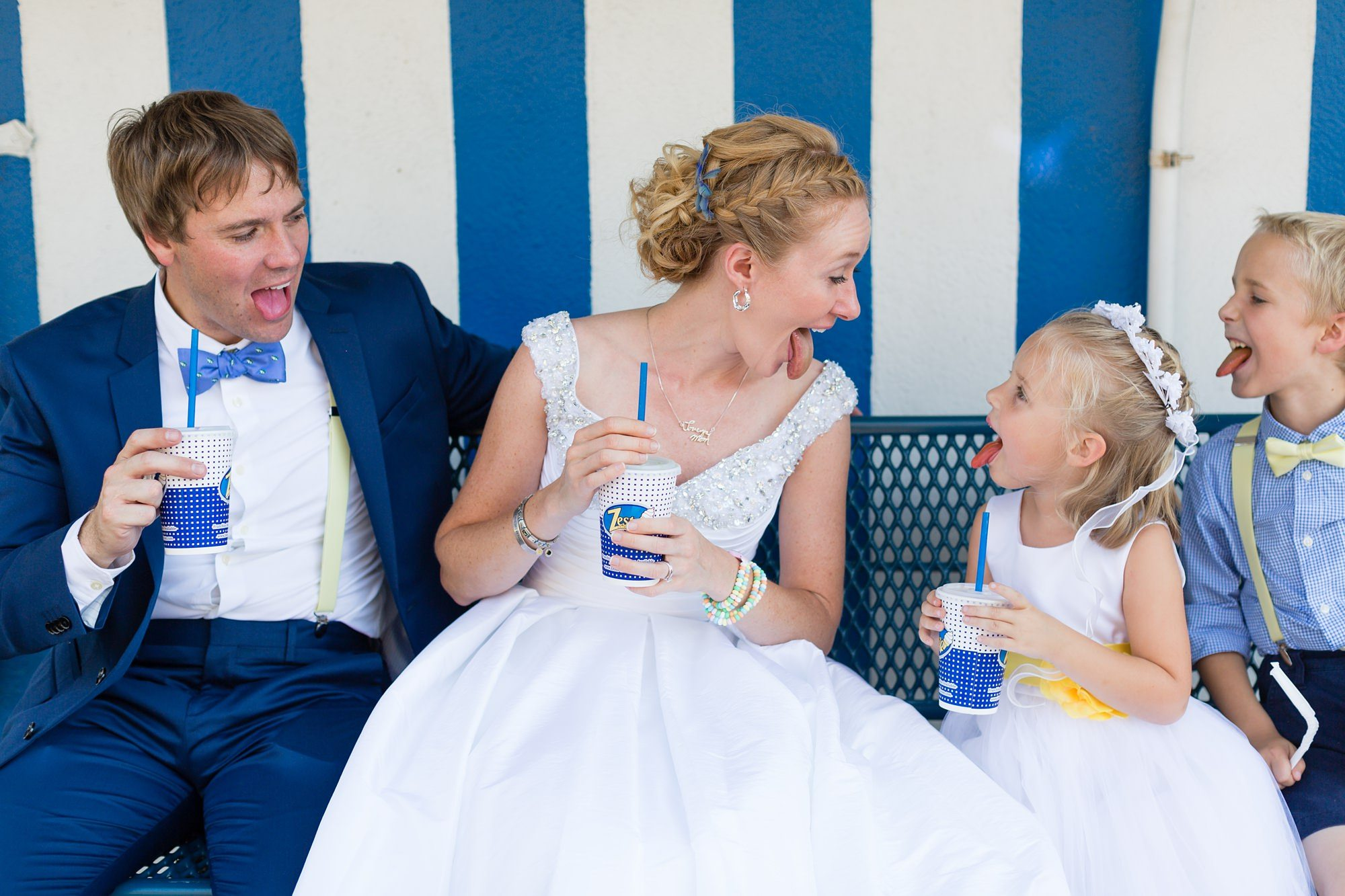 Bride, groom and flower girl all making silly faces Tips for Children at Weddings
