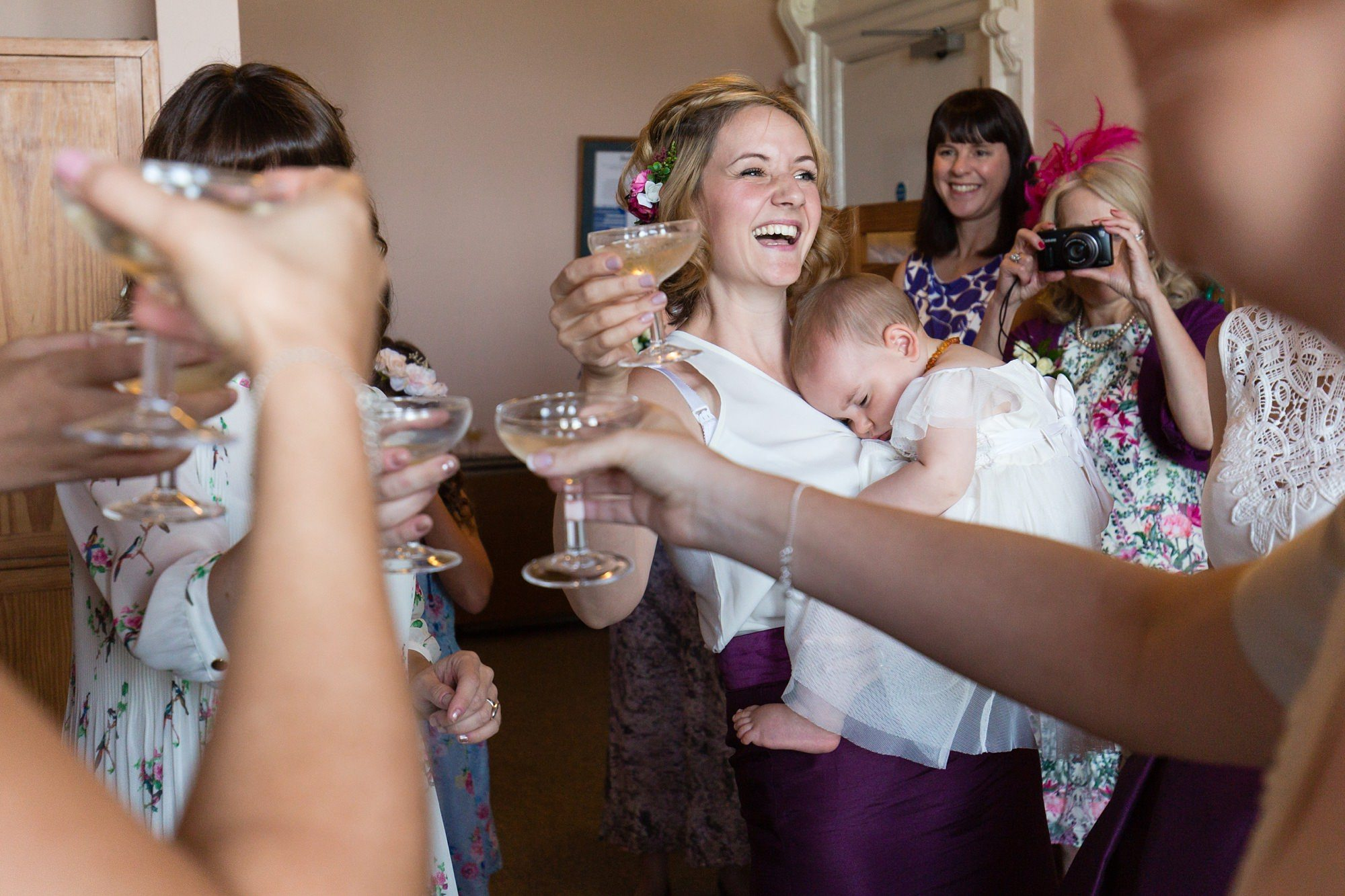 Bridesmaids having toast Derwentwater Independent Hostel Wedding