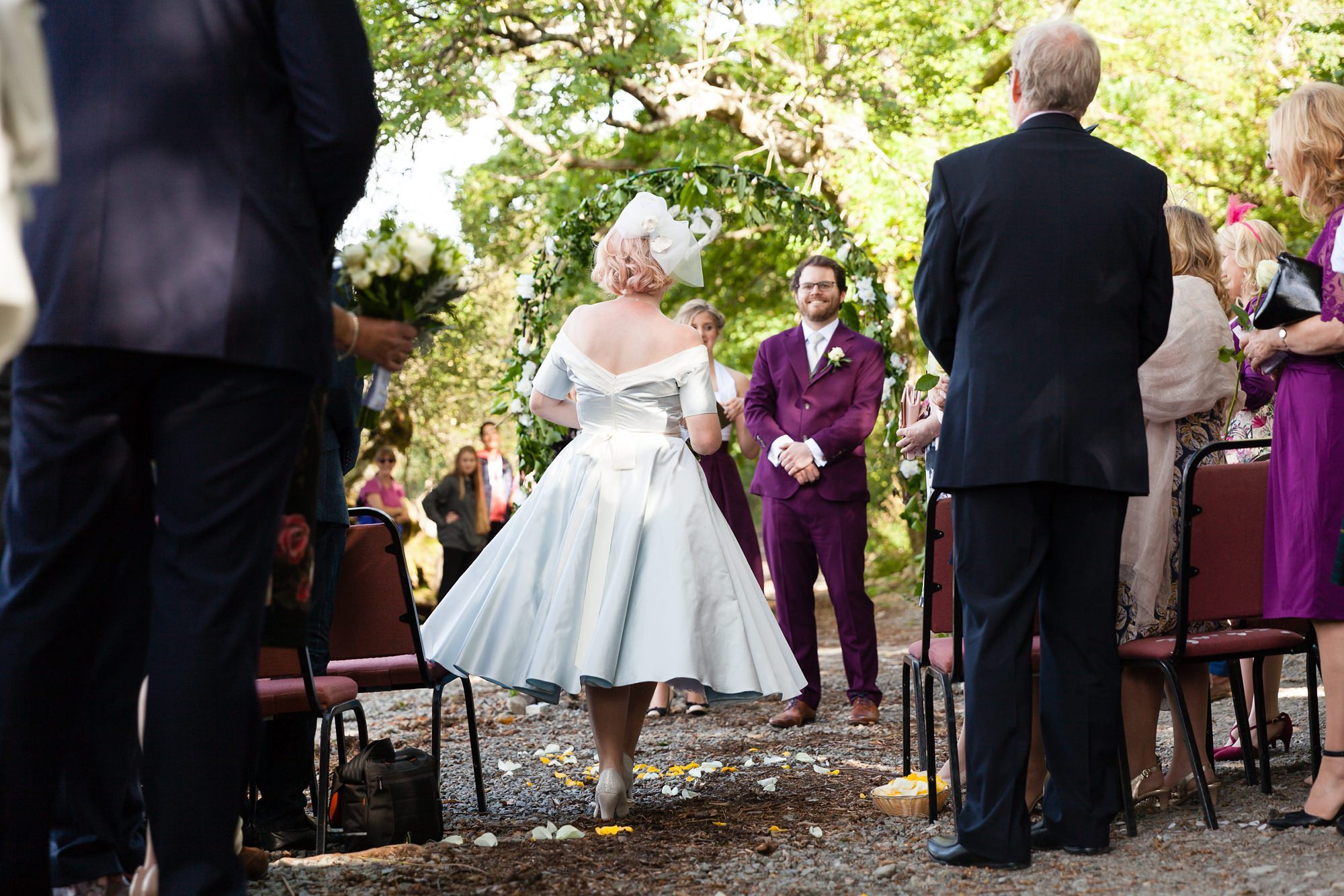 Groom watches as bride walks up aisle Derwentwater Independent Hostel Wedding