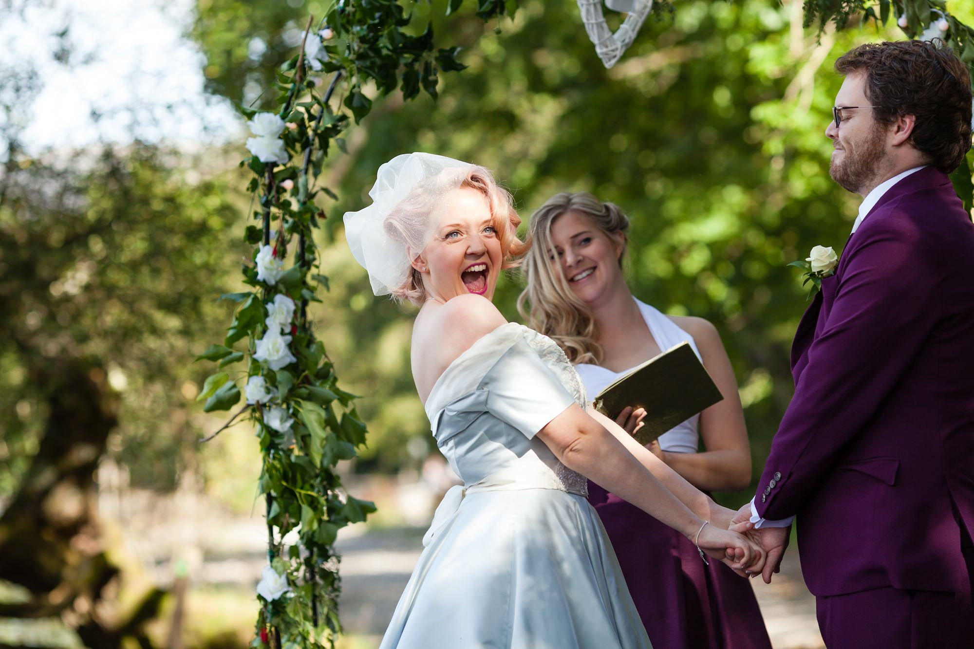 Bride excited during vows Derwentwater Independent Hostel Wedding