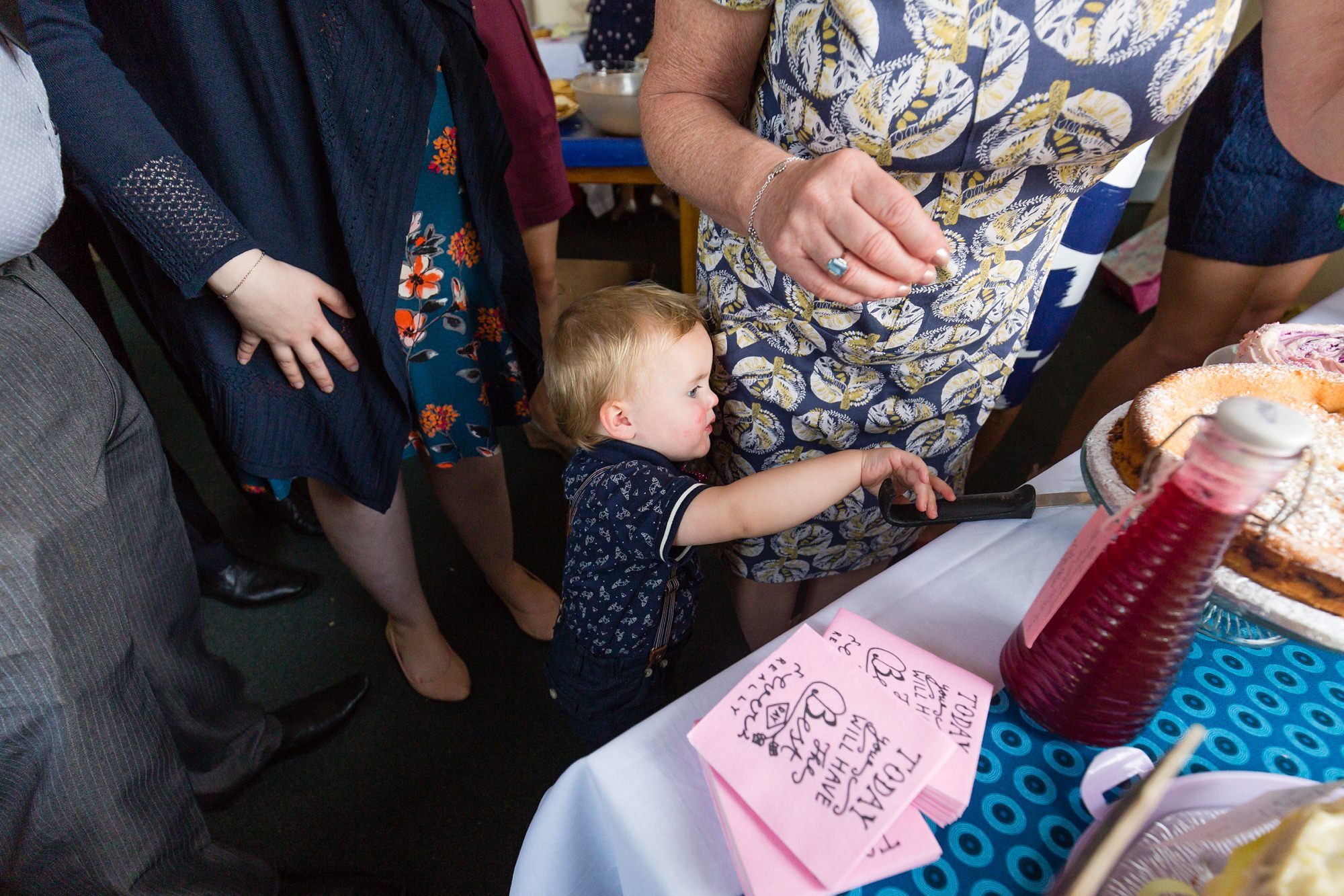 Cheeky baby grabs knife Derwentwater Independent Hostel Wedding