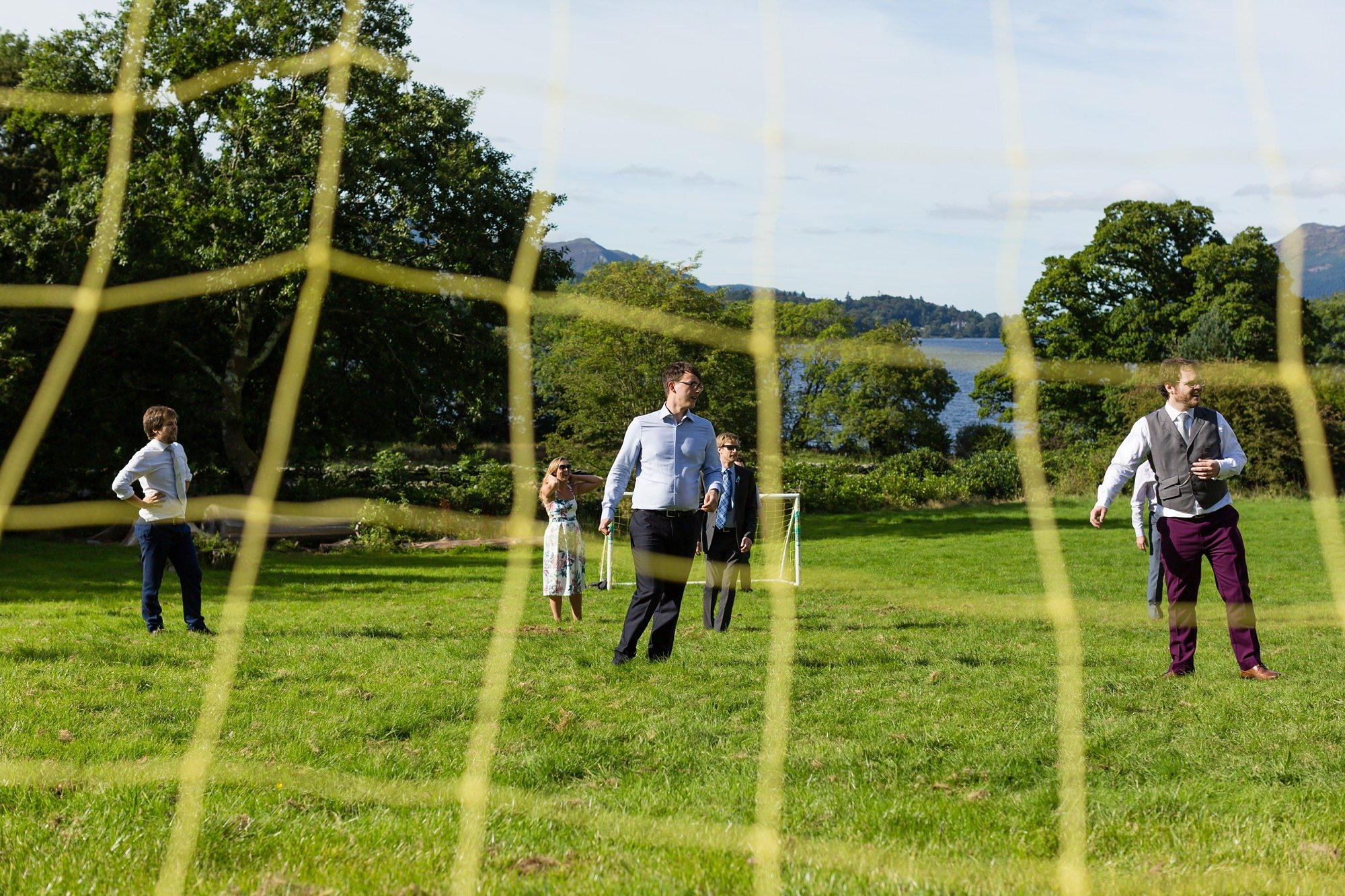 Wedding day football match Derwentwater Independent Hostel Wedding