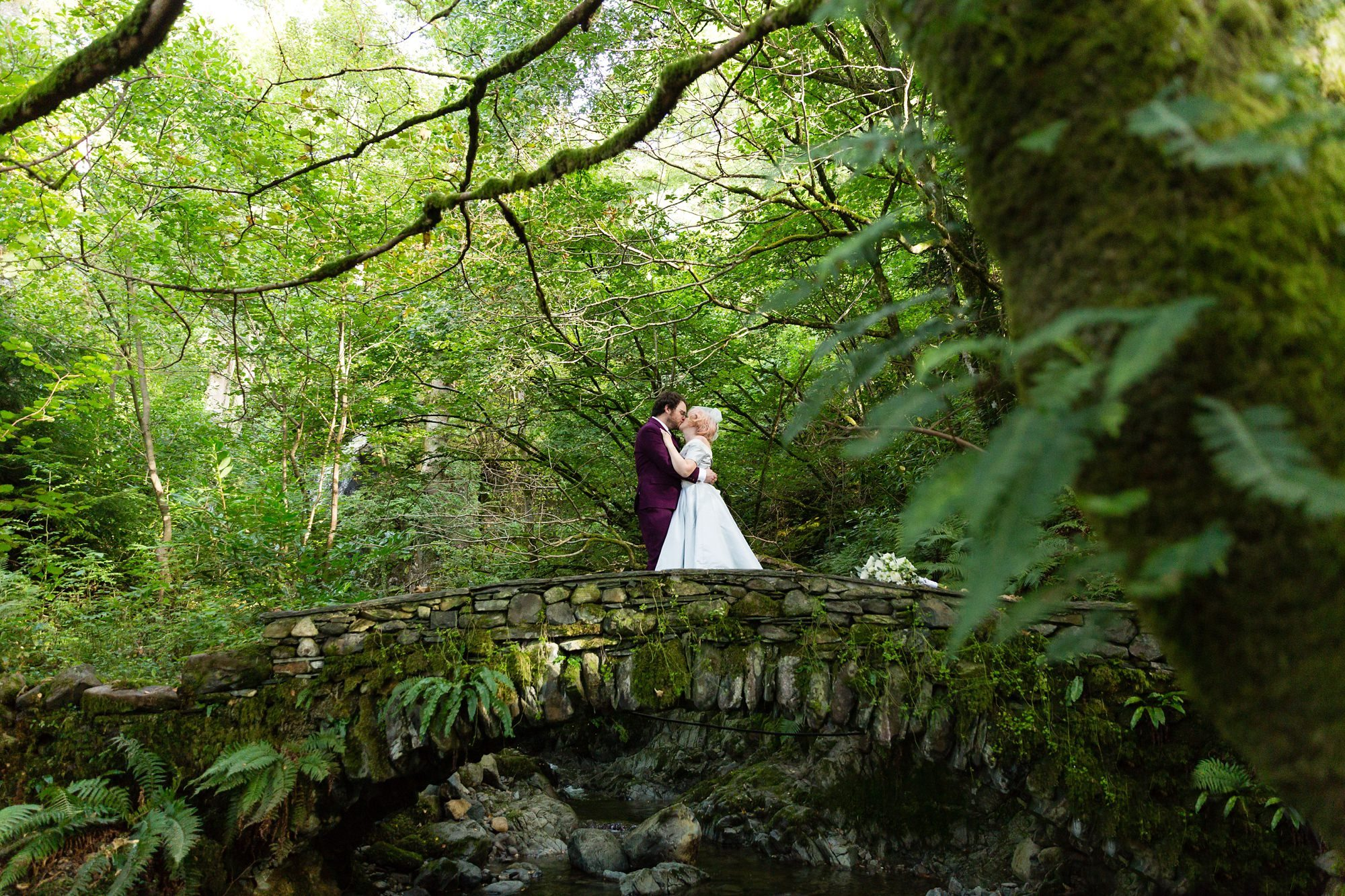 Bride & groom on bridge Derwentwater Independent Hostel Wedding