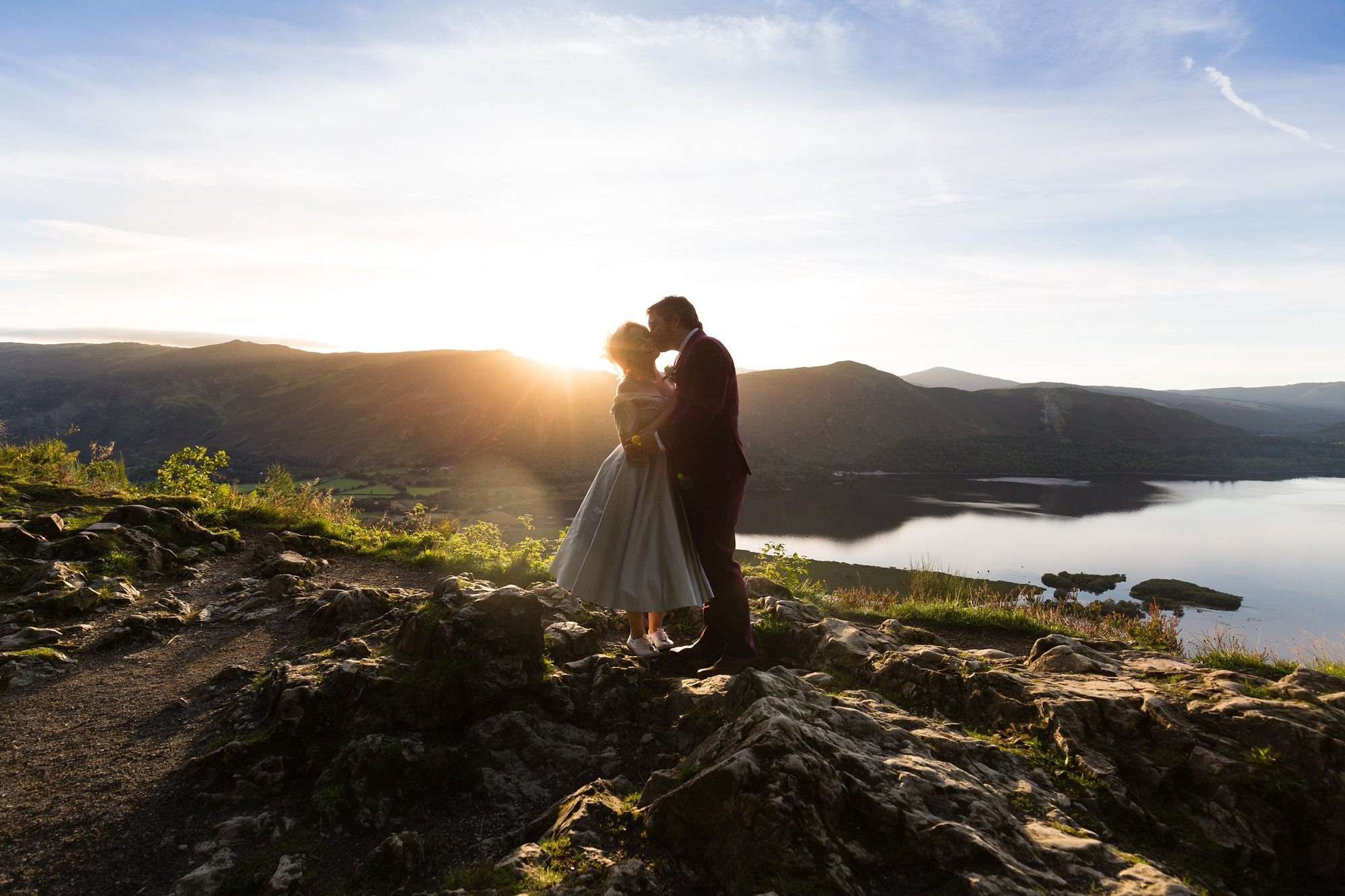 Bride & groom kiss in sunset Derwentwater Independent Hostel Wedding